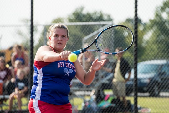 New Oxford's Kamdyn Balko plays a backhand during a singles match against Dover on September 19, 2018.