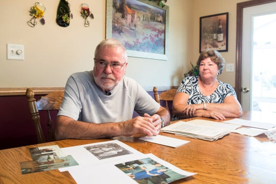 Clyde Funt sits at the dinner table with his wife, Linda, in their Biglerville Borough home. Clyde's father, Allen, was killed in January 1981, and the case remains unsolved. Clyde said his father 'would do whatever he could to help' people, and Clyde thinks that's what he did the morning he was murdered.