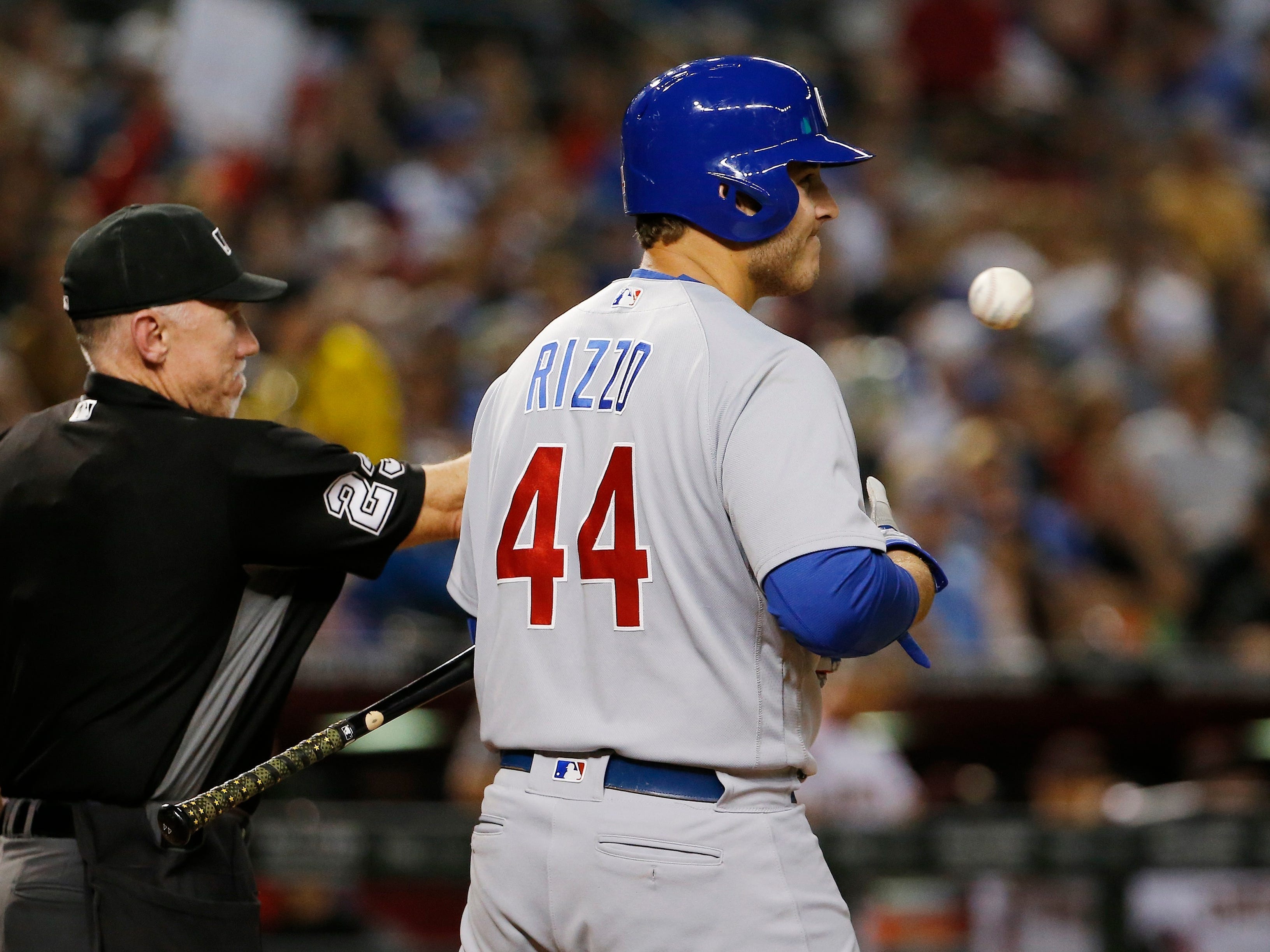 Chicago Cubs' Anthony Rizzo (44) frowns after being called out on strikes by umpire Lance Barksdale, left, during the third inning of a baseball game against the Arizona Diamondbacks on Wednesday, Sept. 19, 2018, in Phoenix.