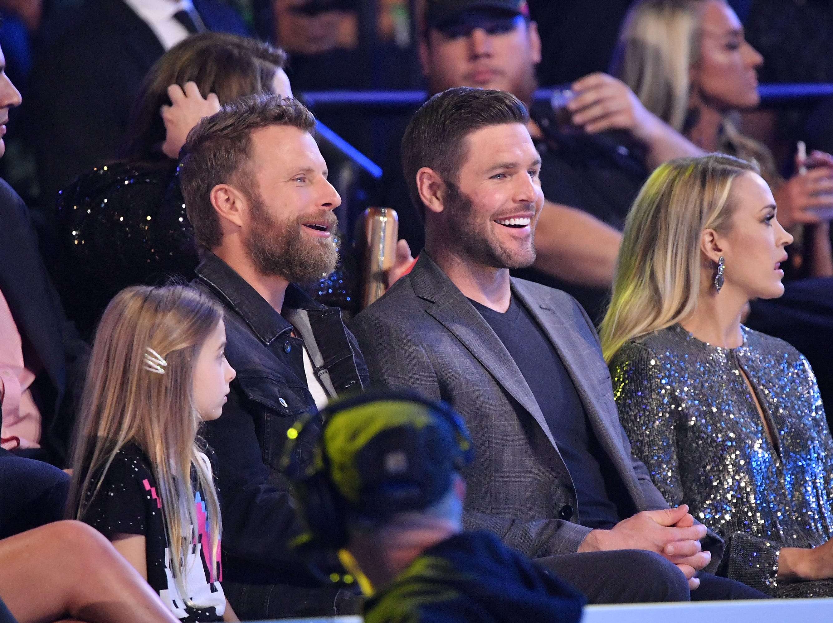 Dierks Bentley (from left), Mike Fisher and Carrie Underwood attend the 2018 CMT Music Awards on June 6, 2018 in Nashville.