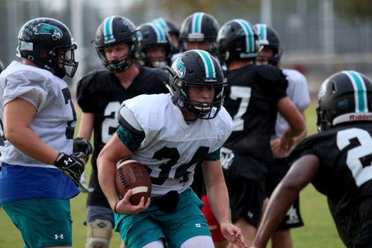 Kohner Cullimore tries to juke out the defender during practice at Highland High School on Sept. 19, 2018.