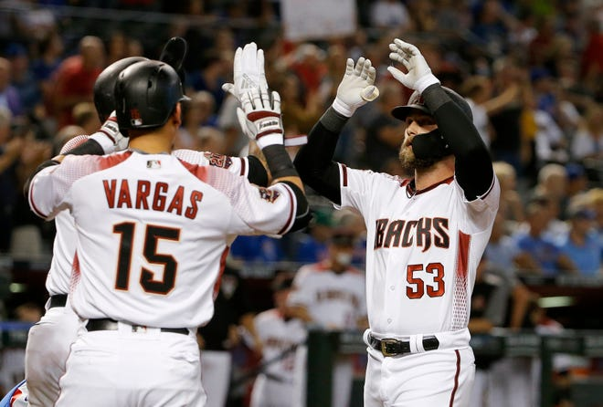 Arizona Diamondbacks first baseman Christian Walker (53) celebrates his three-run home run against the Chicago Cubs with Ildemaro Vargas (15) and Ketel Marte, back left, during the first inning of a baseball game Wednesday, Sept. 19, 2018, in Phoenix.
