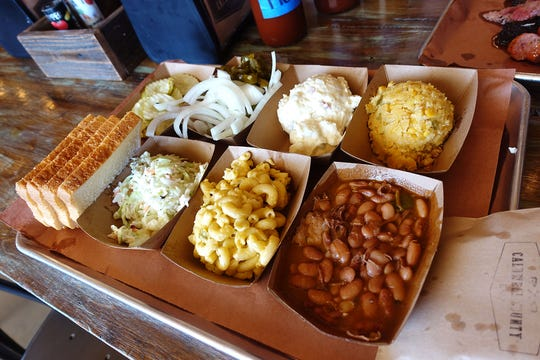 A tray of sides at Caldwell County BBQ in Gilbert.