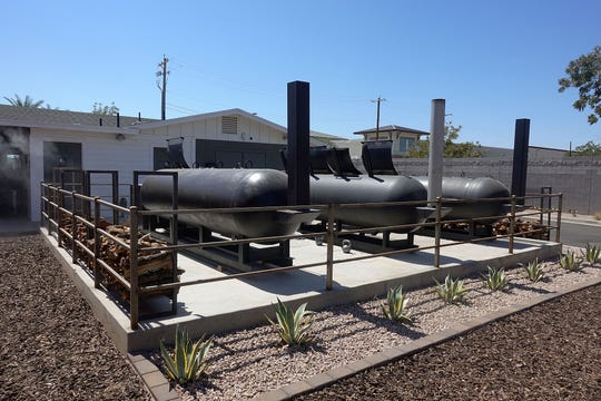 Three 1,000-gallon smokers sit behind Caldwell County BBQ in Gilbert.