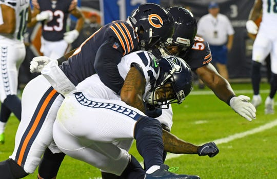 Seahawks receiver Brandon Marshall (15) is tackled by Bears linebacker Khalil Mack (52) during the second quarter of a game Monday at Soldier Field.