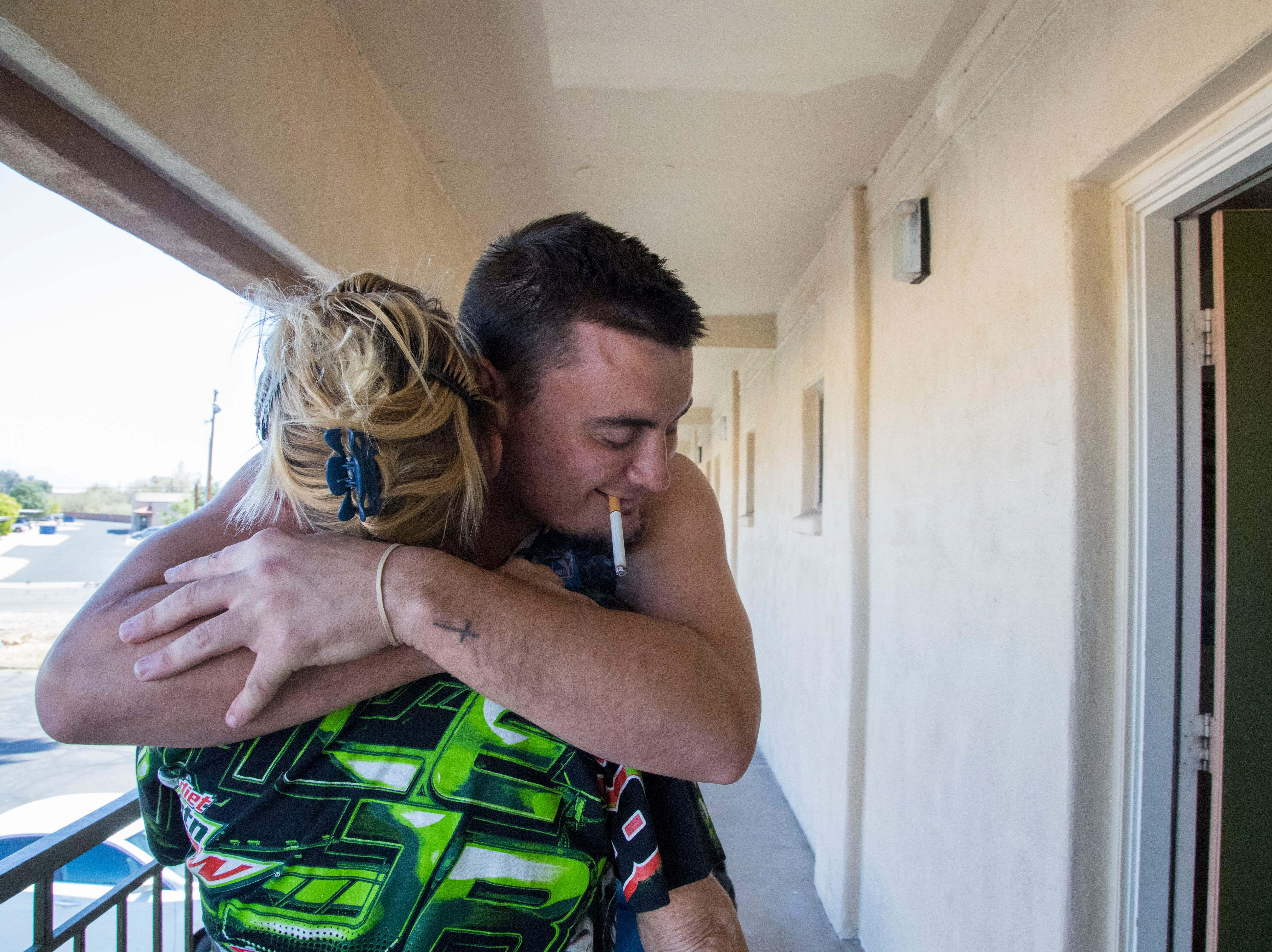 """Cody Ramos hugs his mom, Lana Long, at the Mesa motel he shares with her, his father and younger brother. Even though things remained difficult, Ramos tried to stay optimistic. """"Me making my mom happy overcomes all of that. There's so much I can be doing."""""""