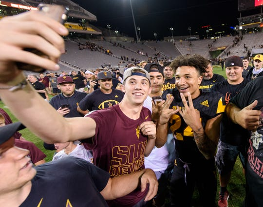 Arizona State's Chase Lucas was the last player to leave the field as he celebrates with fans after a big win over Washington on Saturday, Oct. 14, 2017, at  Sun Devil Stadium in Tempe, Ariz.