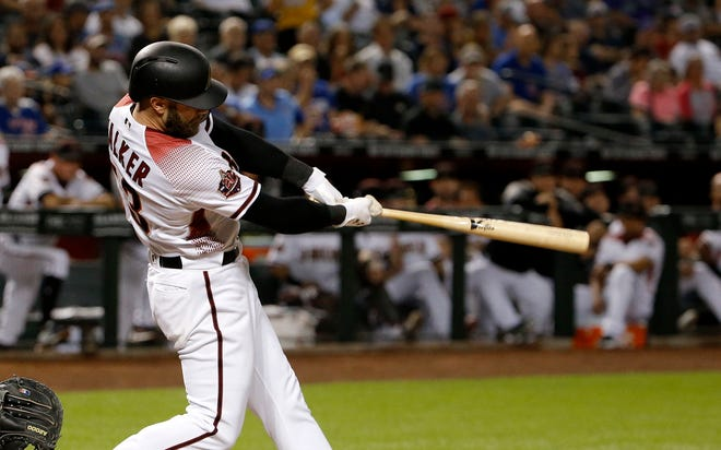 Arizona Diamondbacks' Christian Walker connects for a three-run home run against the Chicago Cubs during the first inning of a baseball game Wednesday, Sept. 19, 2018, in Phoenix.