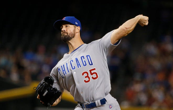 Chicago Cubs starting pitcher Cole Hamels throws a pitch to an Arizona Diamondbacks batter during the first inning of a baseball game Wednesday, Sept. 19, 2018, in Phoenix.