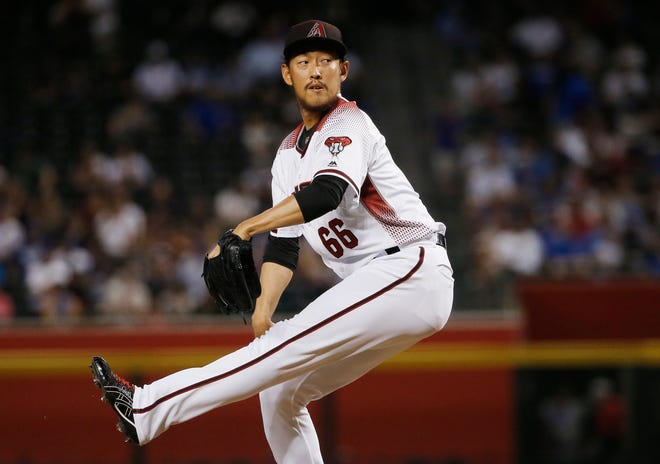 Arizona Diamondbacks relief pitcher Yoshihisa Hirano, of Japan, winds up during the eighth inning of the team's baseball game against the Chicago Cubs on Wednesday, Sept. 19, 2018, in Phoenix. The Diamondbacks defeated the Cubs 9-0. (AP Photo/Ross D. Franklin)