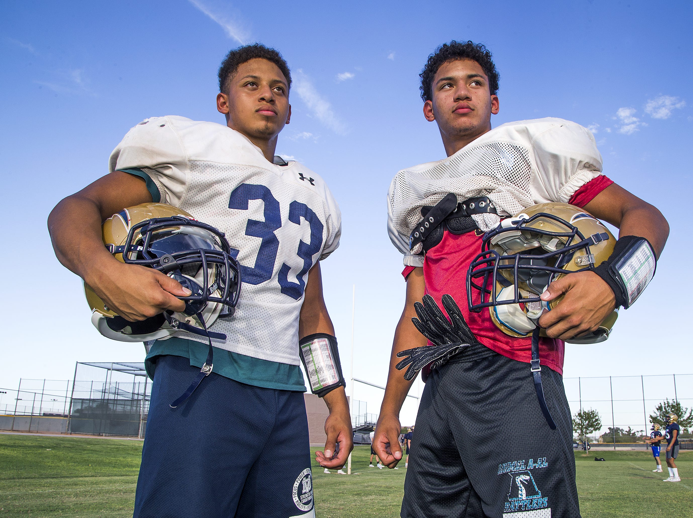 Brothers Tyson, left, and Devon Grubbs are a running back duo for Desert Vista High School that has led the team to a 4-0 start.
