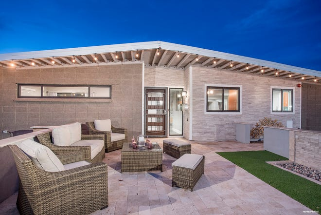 The seating area on the front patio is a great place for entertaining, as is the backyard.