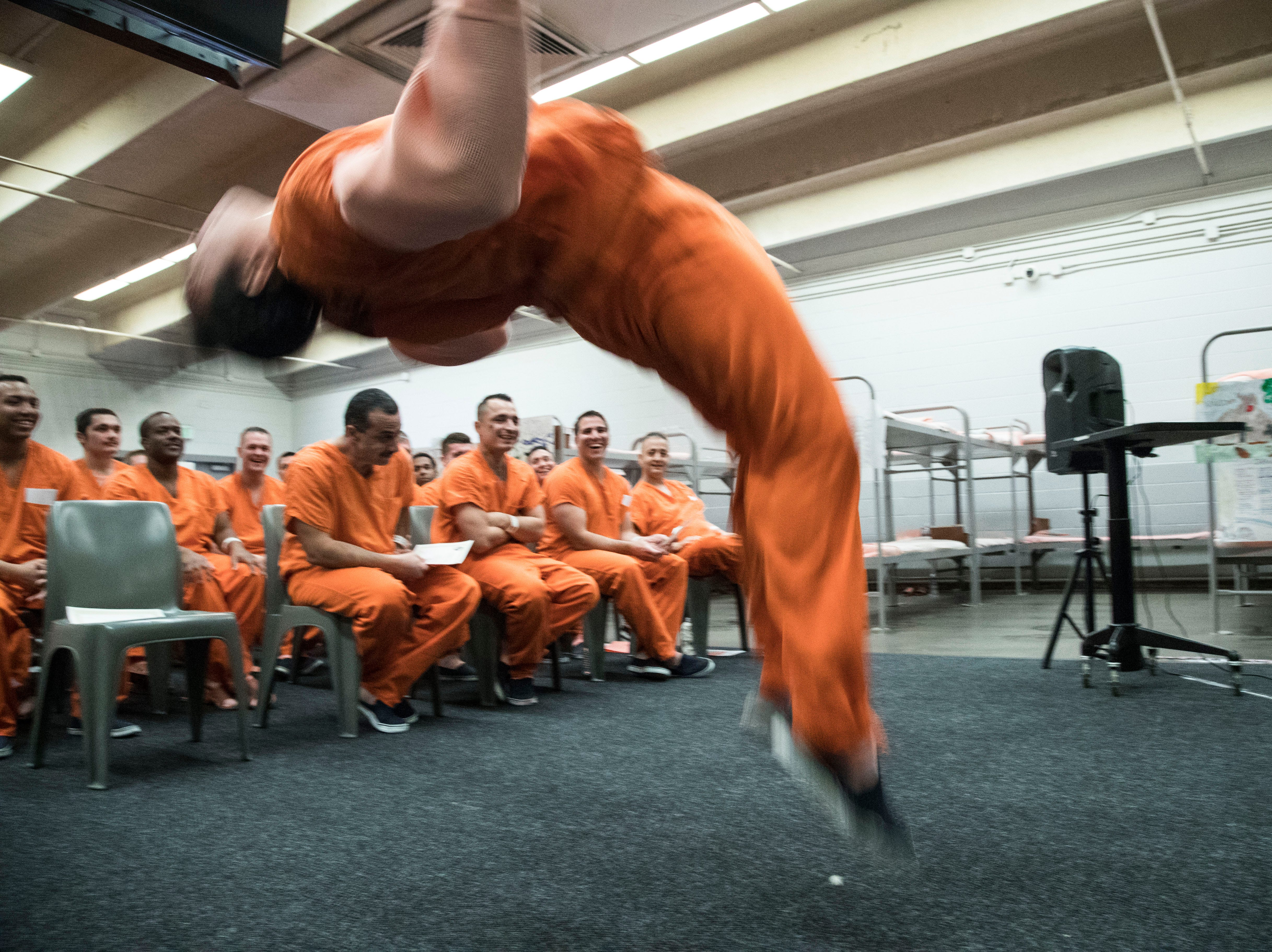 Maricopa County Durango Jail inmates cheer during their graduation from Mosaic, a substance-abuse and mental-health rehabilitation program inside the jail that identifies inmate trauma contributing to their addiction.  An evolution of the longstanding Alpha program, Mosaic leaders say once that trauma is isolated during the seven-week program, and inmates learn better-coping skills, they'll be less likely to start using again.
