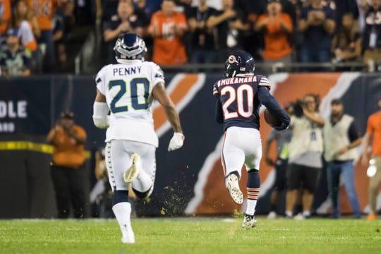 Bears defensive back Prince Amukamara (20) returns an interception for a touchdown during a game against the Seahawks.