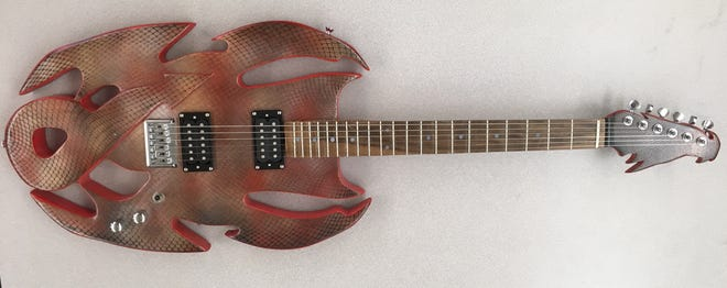 Students create custom designs like this one as they build electric guitars during a class at Palmyra Area High School.
