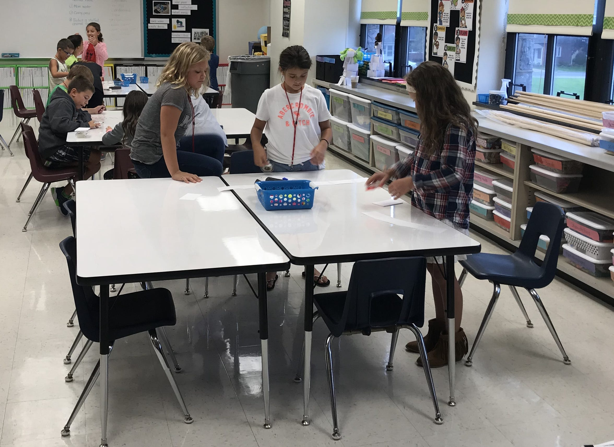 Third grade students at Annville Elementary School build a container to keep a stuffed giraffe dry in the rain during a STEAM special on Monday, Sept. 17.