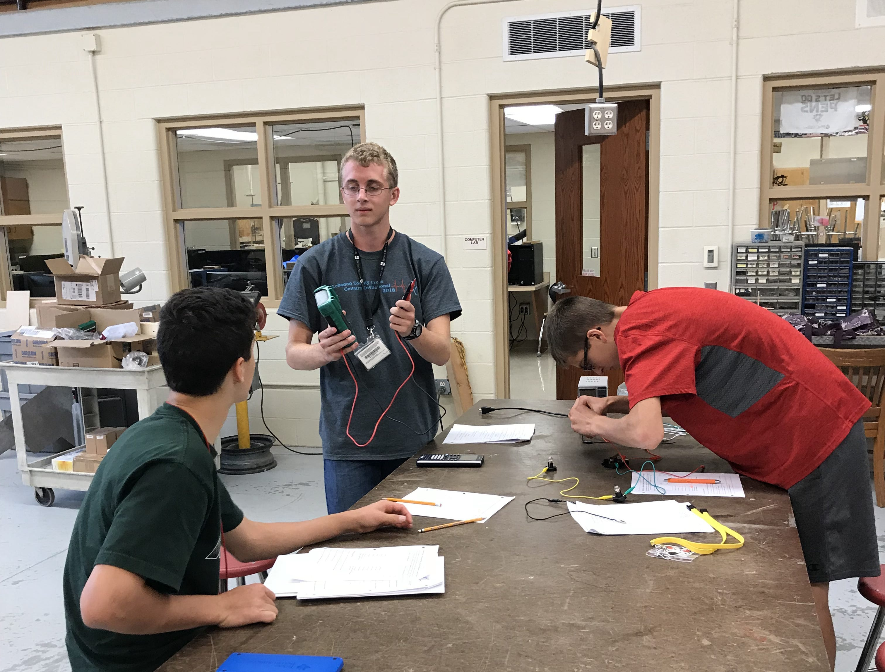 Senior Ethan Fortuna, center, explains a point about electric circuits to classmates in Annville-Cleona's STEM-focused Project Lead The Way class.