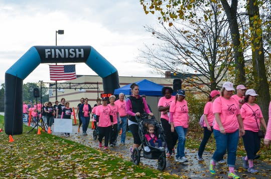 Walkers start their 2-mile trek during the annual Take a Shot at Breast Cancer event in Fort Gratiot.
