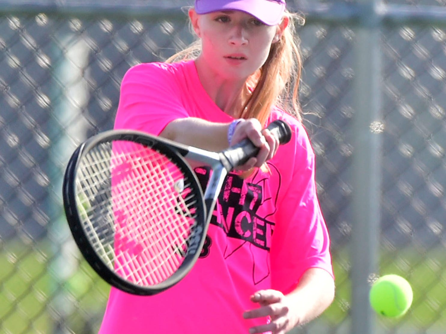Amber Clark of James Buchanan volleys against her Middletown during tennis action Thursday, September 20, 2018.
