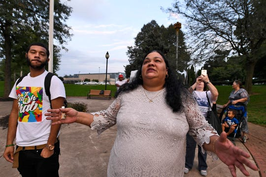 Raul Miranda, left, and Olga Davis watch lanterns float over Kiwanis Lake in memory of Erik Miranda, Thursday, Sept. 20, 2018. Miranda was murdered Sept. 20, 2015, in a drive-by shooting. His case is one of only a few cold cases in York City. John A. Pavoncello photo