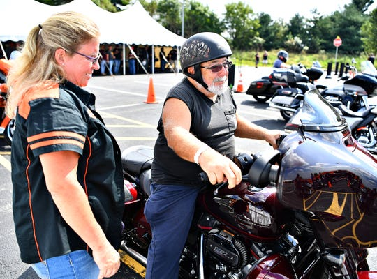 Tina Campbell, left, of Harley-Davidson, prepares to send off a demo rider during the York Bike Week Harley-Davidson York Vehicle Operations Open House in Springettsbury Township, Thursday, Sept. 20, 2018. Dawn J. Sagert photo