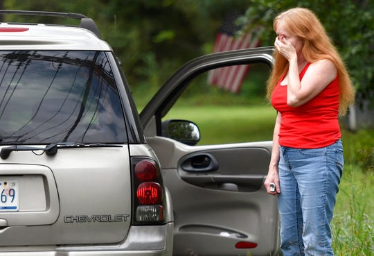 "Shirley Pollack, of Perryville, Md. reacts to what authorities have called a shooting with multiple victims in Perryman, Md. on Thursday, Sept. 20, 2018. Authorities say multiple people have been shot in northeast Maryland in what the FBI is describing as an ""active shooter situation.""   Pollack,was concerned about her son  who worked near the scene of the shooting.  (AP Photo/Steve Ruark)"