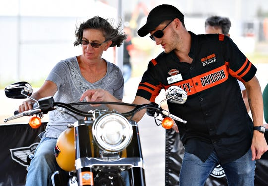 Beverly French, left, of Barnesville, Oh., is directed by Alex Mudd, a Harley-Davidson engineer, during the York Bike Week Harley-Davidson York Vehicle Operations Open House in Springettsbury Township, Thursday, Sept. 20, 2018. Dawn J. Sagert photo
