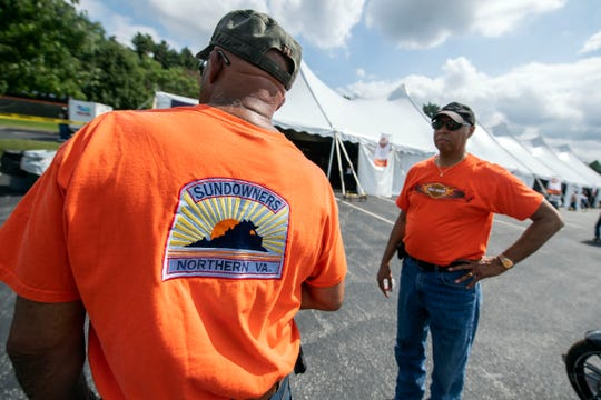 Maurice Hampton, left, shows off his 'Sundowners' shirt at the Harley-Davidson open house, and event leading up to the 24th annual York Bike Night on Saturday . Maurice and his cousin, Ron Hampton, right, drove up from Fairfax, Va., to enjoy the open house and see the latest motorcycle models.