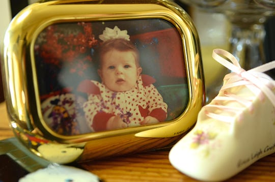 A framed photo of then 23-year-old Erica Greif is displayed in her mother's living room at her Reno home.