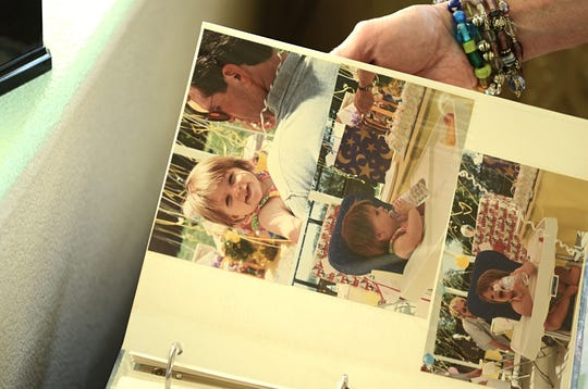 Trisha Greif holds a family album with photos of her then 23-year-old daughter, Erica Greif, who was killed in a head-on crash in April 2015. Erica Greif, a well-known Reno cyclist, will be honored in a dedication on Sept. 22, 2018.