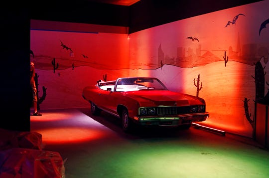 In this Tuesday, Sept. 18, 2018 photo, a Chevrolet Caprice owned by Hunter S. Thompson is on display at the Cannabition cannabis museum in Las Vegas. The museum celebrating all things cannabis with displays that include a glass bong taller than a giraffe and huggable faux marijuana buds is the newest tourist attraction in Las Vegas.