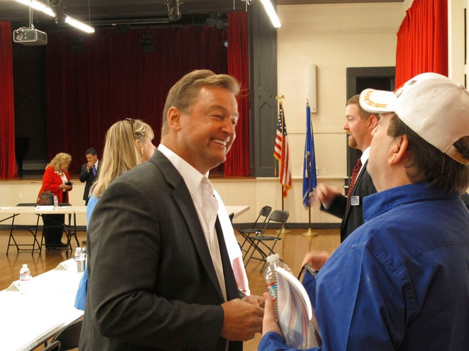 In this Friday, Sept. 14, 2018 photo, Sen. Dean Heller, R-Nev., listens to a veteran's concerns following a roundtable in Reno, Nev. Heller is considered one of the most vulnerable GOP incumbents running in November in his race against Rep. Jacky Rosen, D-Nev. Heller is set to hold his second campaign rally and fundraiser with President Donald Trump Thursday and Friday in Las Vegas.