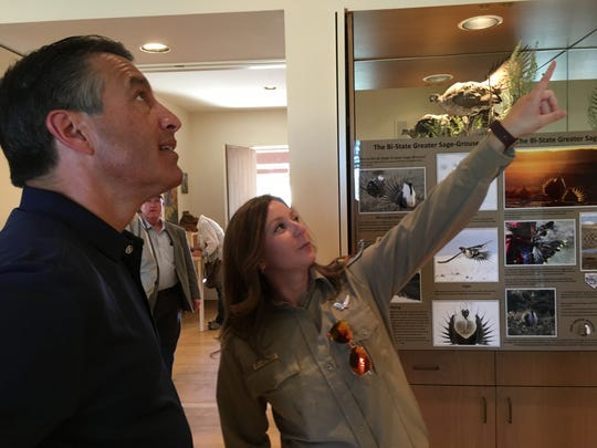 Gov. Brian Sandoval tours the Pitchfork Ranch visitor center at the Walker River State Recreation Area with Heather Jolley of Nevada State Parks on Sept. 19, 2018.