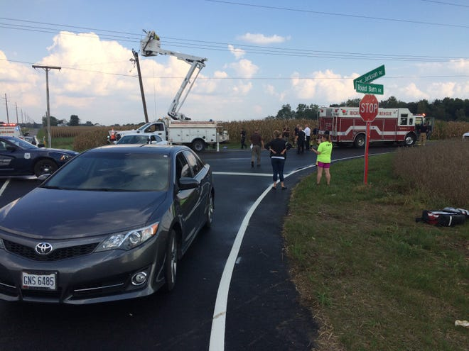 Two people were injured and two vehicles damaged Thursday afternoon in a collision at the intersection of Round Barn and Gaar Jackson roads.
