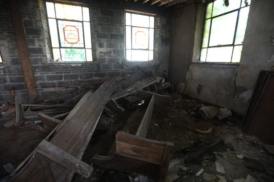 The front of the synagogue suffered damage to seating areas, walls, and ceiling.