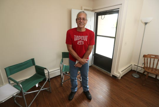 Raul Sepulveda in the apartment he shares with his wife Maria after coming to Rochester from Puerto Rico after Hurricane Maria.