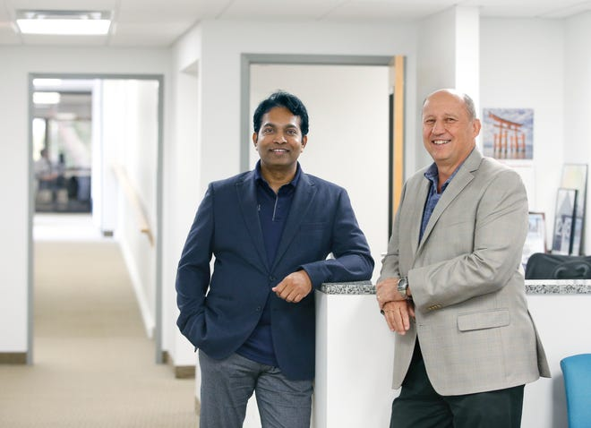 Avani Technology Solutions president and CEO Sameer Penakalapati (left) and vice president and COO Mitch Meller.