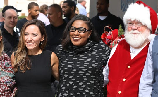 Rochester Mayor Lovely Warren, center, poses with Kelli Marsh, Roc Holiday Village founder, left, and Santa, following the inaugural Roc Holiday Village press conference announcing plans for the new downtown event in Rochester, Thursday, Sept. 20, 2018 in Rochester.