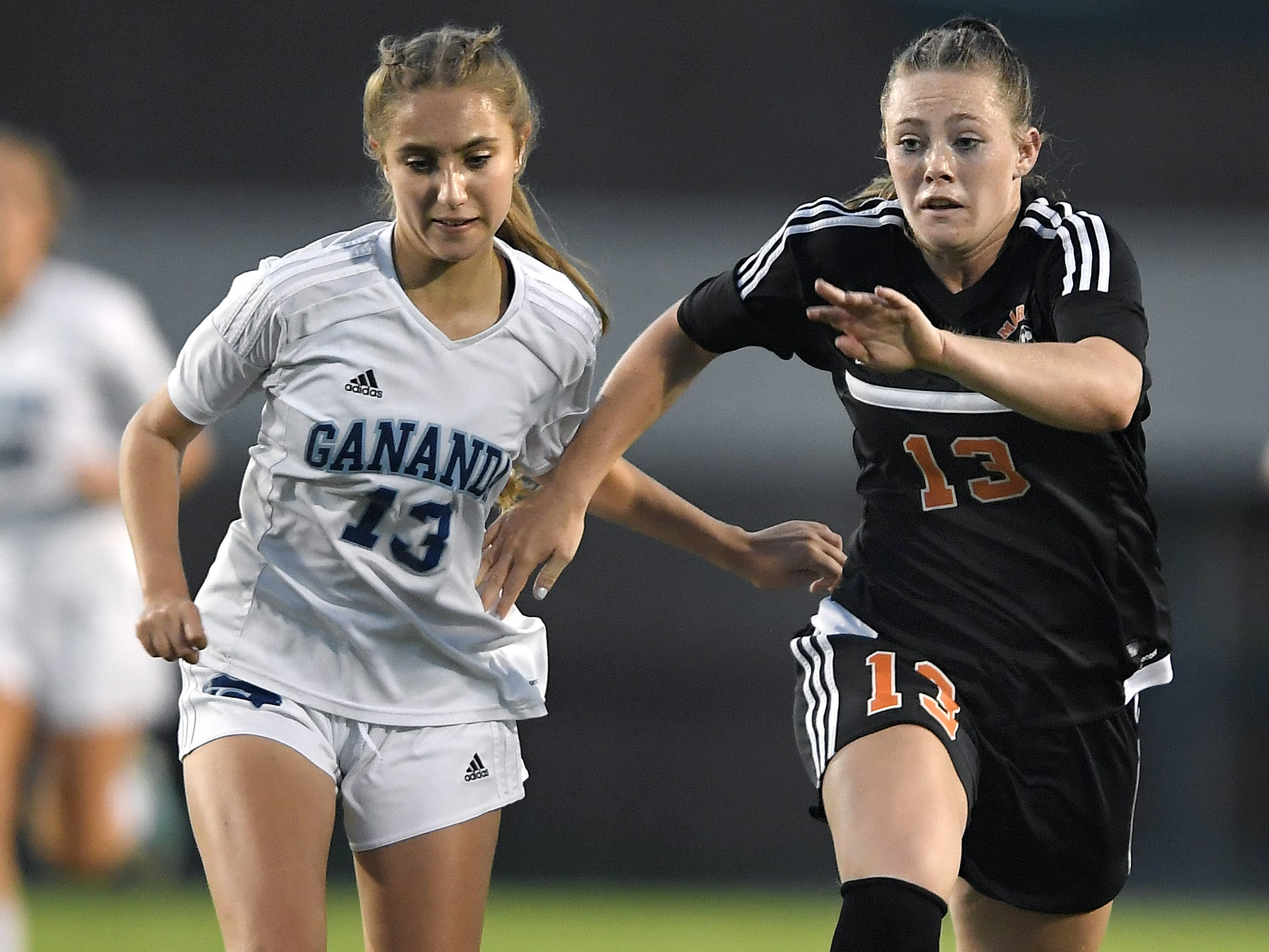 Marion's Chloe DeLyser, right, shown in a game against Gananda earlier this season, scored five goals on Friday night to set the state record for most goals in a career (256) and season (75).