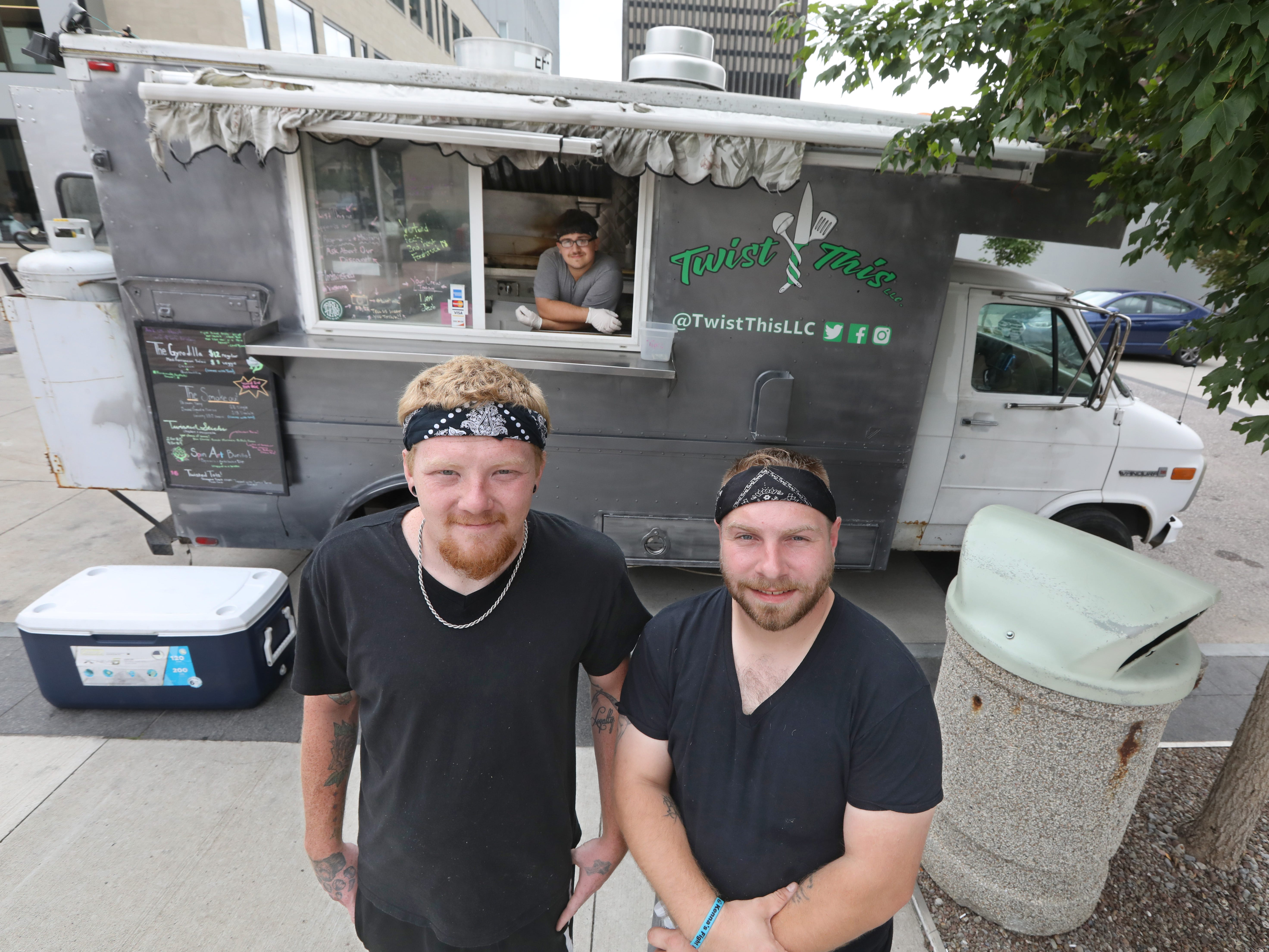 The faces behind the new Twist This food truck  are co-owners Kota Briley, left, and Daniel Brentson, right, and employee Jacob Balzano, back center, in Rochester Wednesday, Sept. 19, 2018.