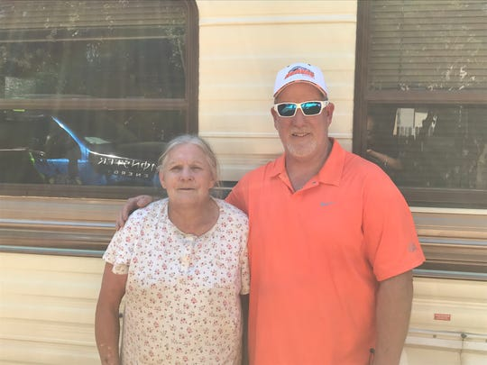 Carr Fire victim Lynn Adams and Jim Elliott, who heads a new nonprofit to help people affected by the wildfire, outside the donated fifth wheel trailer Adams moved into on September 19. Elliott arranged housing for Adams, who lost her rental home in the wildfire.