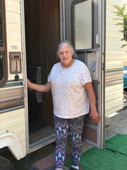 Carr Fire victim Lynn Adams steps out of her donated fifth wheel trailer in Redding. After her rented house went up in flames, Adams was living on the property in a donated tent.