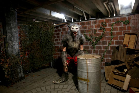 Nick Hardwood, a students at the Oregon School for the Deaf, practices dressing in his werewolf costume on Wednesday, Sep. 19, 2018. Hardwood also participated in decorating the set for The Nightmare Factory which opens Friday, Oct. 5.