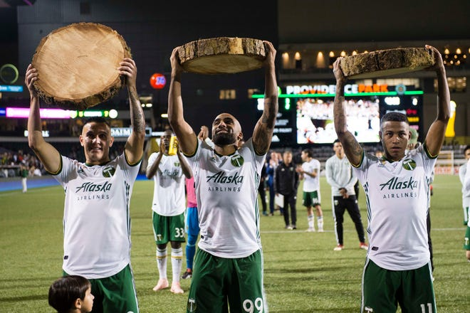 Sep 19, 2018; Portland, OR, USA; Portland Timbers midfielder David Guzman (20), forward Samuel Armenteros (99) and forward Andy Polo (11) celebrate after a game against the Columbus Crew at Providence Park. The Portland Timbers won 3-2. Mandatory Credit: Troy Wayrynen-USA TODAY Sports