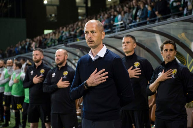 Sep 19, 2018; Portland, OR, USA; Columbus Crew head coach Gregg Berhalter stand during the national anthem before a game against the Portland Timbers at Providence Park. The Portland Timbers won 3-2. Mandatory Credit: Troy Wayrynen-USA TODAY Sports
