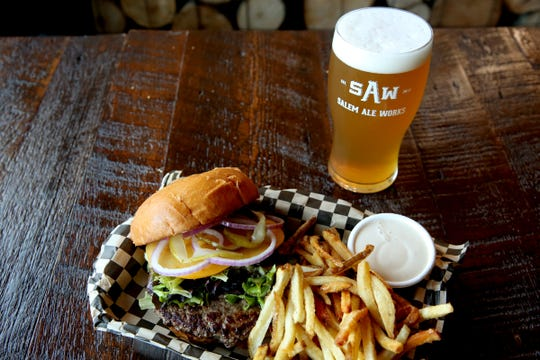 The SAW Classic Burger with fries and the Partly Hazy IPA are offered at Salem Ale Works for Salem Dining Month. For the entire month of October, participating Salem restaurants will offer a beverage and two courses of their choosing for $30 a person. Photographed at Salem Ale Works on Wednesday, Sep. 19, 2018.