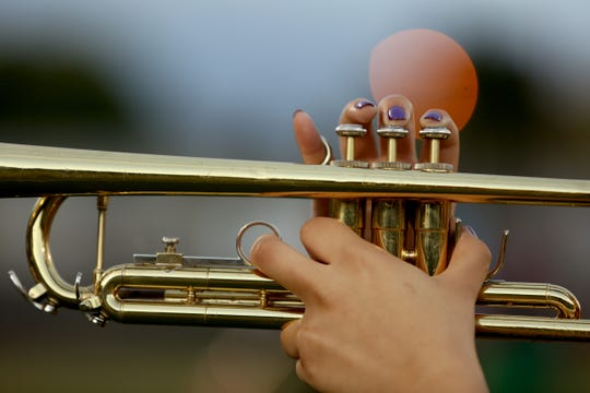 The North Salem trumpeter rehearses with the marching band at North Salem High School on Wednesday, Sep. 19, 2018.