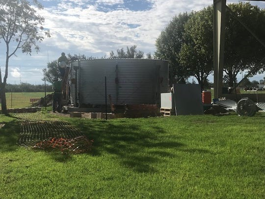 Workers building the new rainwater harvesting system Thursday, Sept. 20, 2018 at Kirby Park