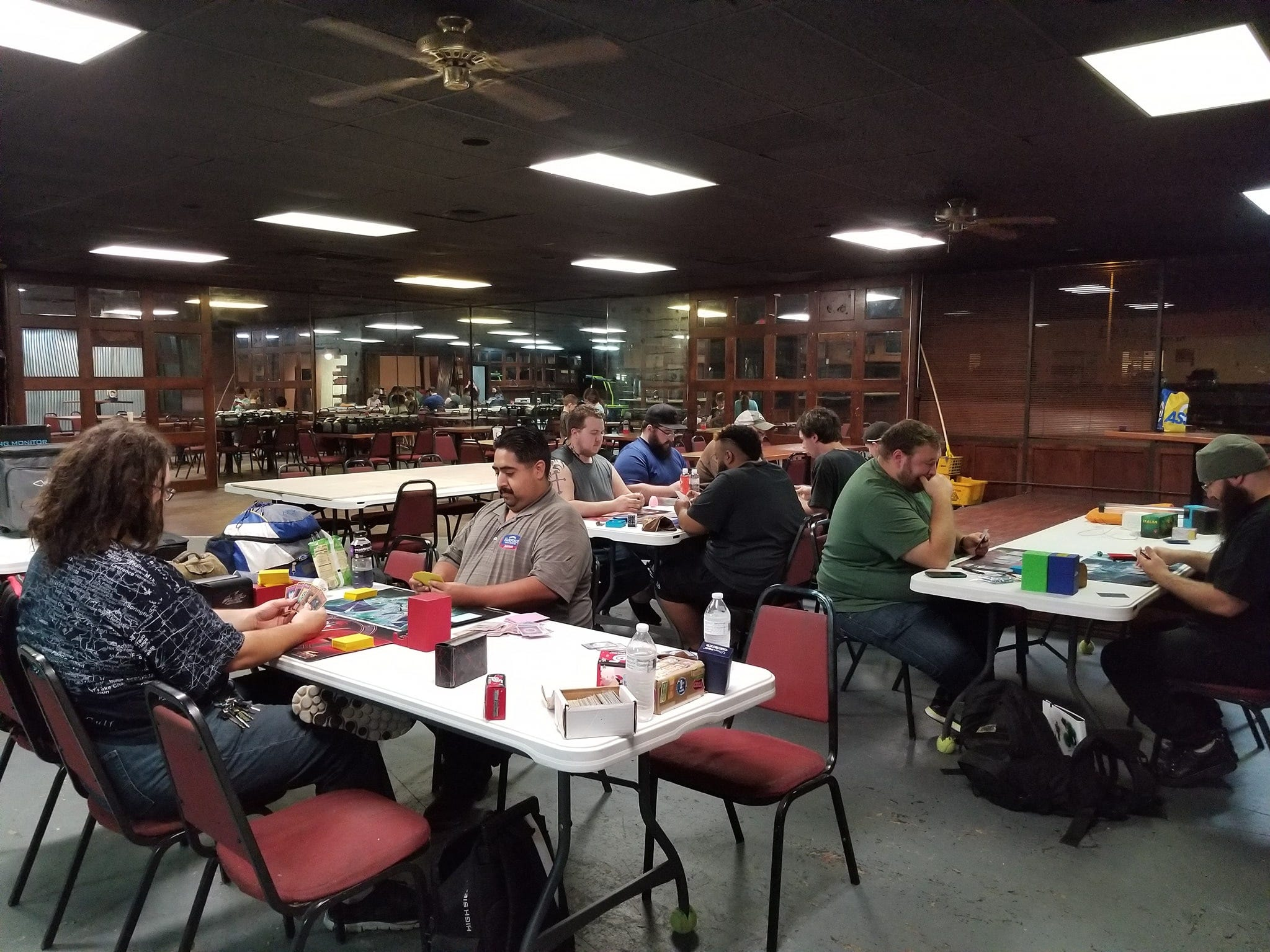 People playing Magic the Gathering and Yu-Gi-Oh at Phat Catz Gaming, 2019 N Bryant Blvd.