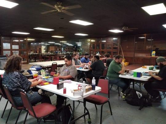 People playing Magic the Gathering and Yu-Gi-Oh at Phat Catz Gaming, 2019 N Bryant Blvd.